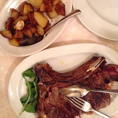 Bistecca alla fiorentina (and potatoes) at L'Osteria di Giovanni. #onthetable #travelgram