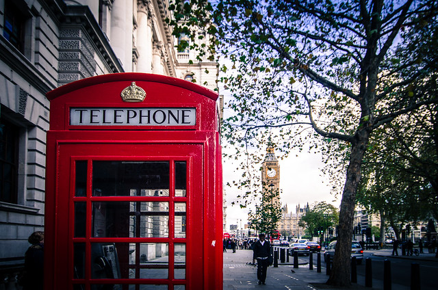 An iconic red telephone box in the heart of London, England.