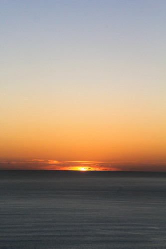 ocean morning blue light orange sun nature sunrise dawn early waves shine pacific horizon gradient ripples