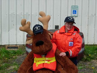 "Coast Guard Auxiliuary member Kate Rogers displays ""Madison Moose,"" a stuffed moose she and her brother use to teach boating safety to children in Kake, Alaska, June 11, 2011. Providing education to mariners and their families in remote communities is an important missions for Auxiliary members in Alaska. U.S. Coast Guard photo provided by Kate Rogers."