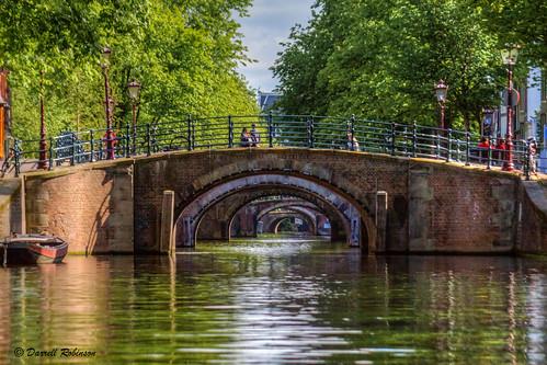 bridge trees sky bw holland reflection green water netherlands amsterdam canon boat canal europe bridges bicycles adobe tamron canoneos50d reguliersgrachtcanal adobelightroom5 adobephotoshopcc photomatixpro5 bwmrcfprouvhazefilter adobebridgecc tamron28300mmf3563divclens