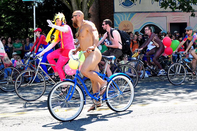 Solstice cyclist at Solstice Parade, Fremont, Seattle, Washington.