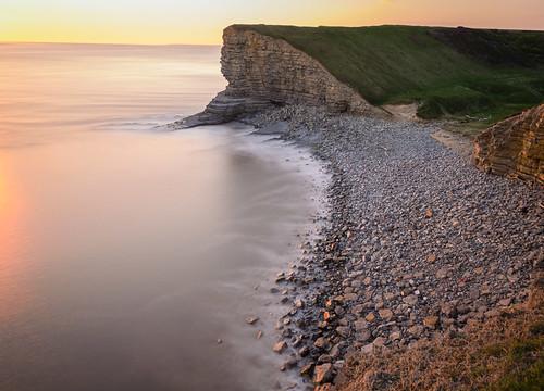 sunset heritage wales point coast rocks waves cliffs severn glamorgan nash hazy risingtide marcross