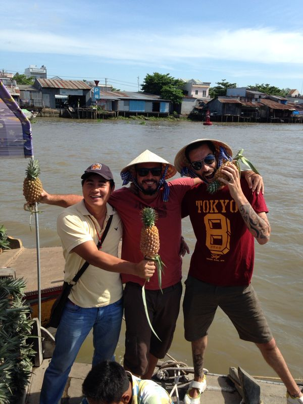 Tourists posing on the Mekong river