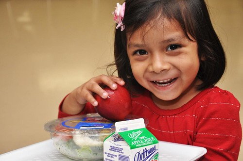 A Los Angeles, CA Unified School student enjoying tasty new meals