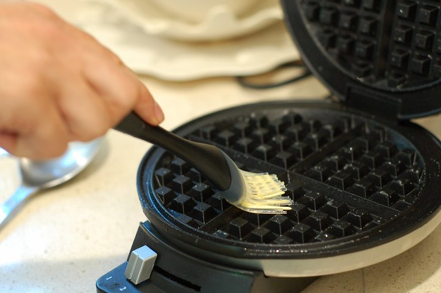 Using a silicon basting brush to grease the waffle iron by Eve Fox, the Garden of Eating copyright 2014