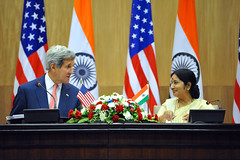 U.S. Secretary of State John Kerry thanks Indian Minister of External Affairs Sushma Swaraj while addressing reporters during a news conference that followed the plenary session of a Strategic Dialogue between the two countries in New Delhi, India, on July 31, 2014. [State Department photo/ Public Domain]