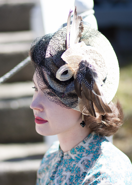 New York Creations 1940s tilt hat in straw with a large black veil and two faux birds perched on either side of the crown
