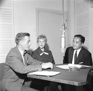 Reporter of the Finnish Broadcasting Company Esko Tommola interviews Armi Hilario (former Armi Kuusela) and her husband Gil Hilario in a radio studio.