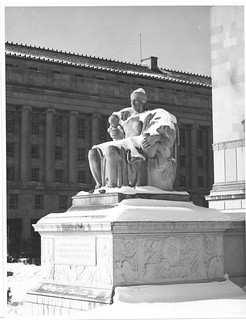 Photograph of the Female Statue, Heritage of the Past, in the Snow near the Constitution Avenue Entrance to the National Archives Building, 01/04/1936