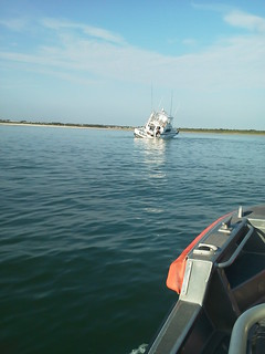Coast Guard assists grounded, flooding boat with 7 people aboard