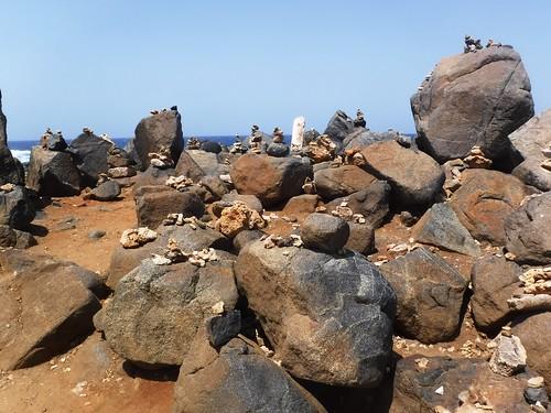 aruba coast surf rugged dangerous waves inukshuk natural stone bridge rock inuksuit