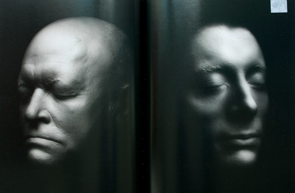 Spread from The Somnambulists: Photographic Portraits From Before Photography. Top, death masks of the poets William Blake, 1757-1827, and John Keats, 1785-1821, photographed by Joanna Kane.