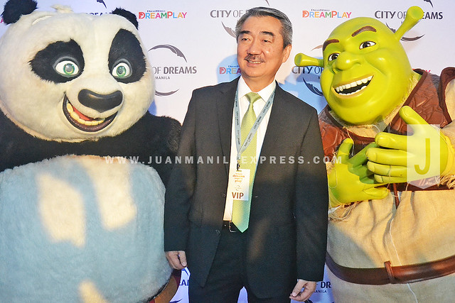 PRECIOUS SMILE. SM Prime Holdings Inc. CEO and President must be in high spirit after he got his picture taken with Po and Shrek.