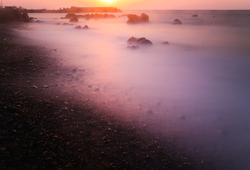 longexposure light sunset seascape beach rock stone landscape spring smooth peaceful pebbles shore coastline serene southkorea jeju silky basaltic