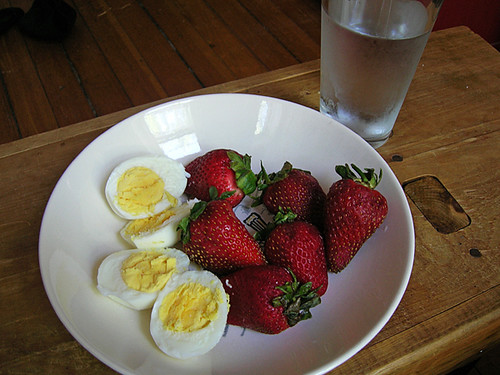 hardboiled eggs, strawberries, water