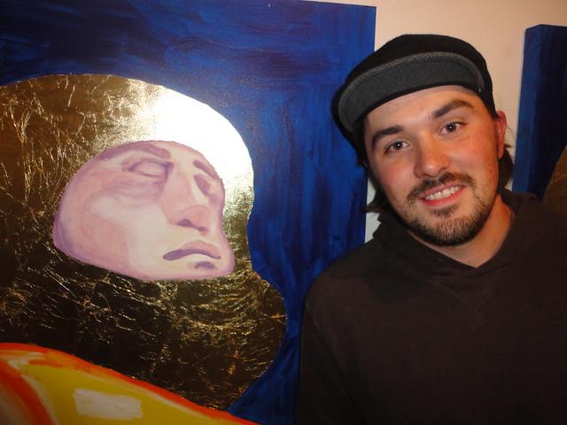Morgan Skinner beside his humour art painting icon cosmonaut
