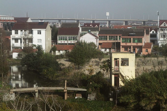 Old stone bridge and new houses near Yuandong Avenue Station