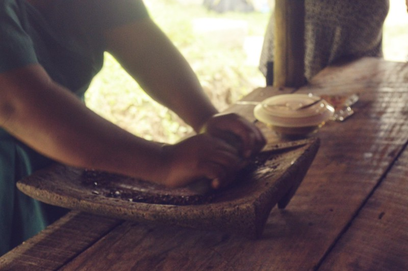 Grinding cacao by hand