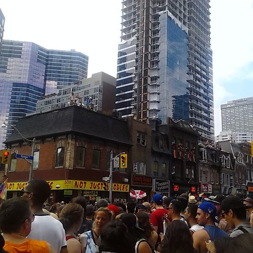 Parade watchers on rooftops at Yonge and Wellesley #worldpride