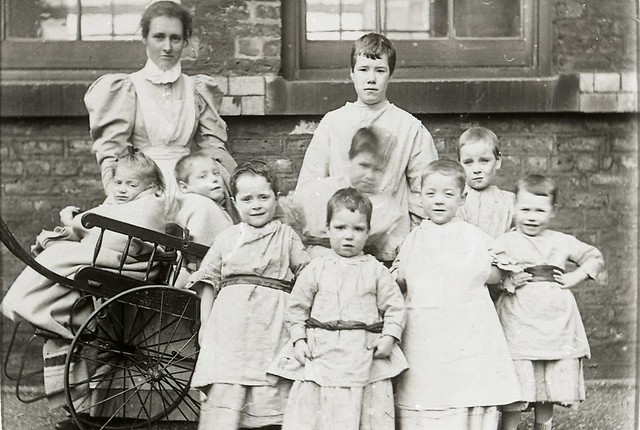 Children and nurse at Crumpsall Workhouse, c.1897