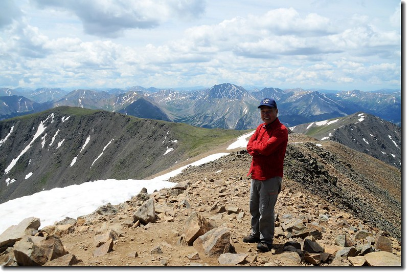 Me on the summit of Mt. Elbert, background us La Plata Peak