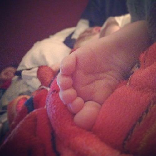 I am sleeping at the bottom of my bed,opposite direction than normal. My view. #babyfeet