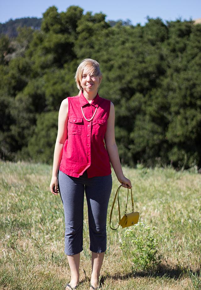yellow crossbody purse, sleeveless red silk blouse, grey stretch capris