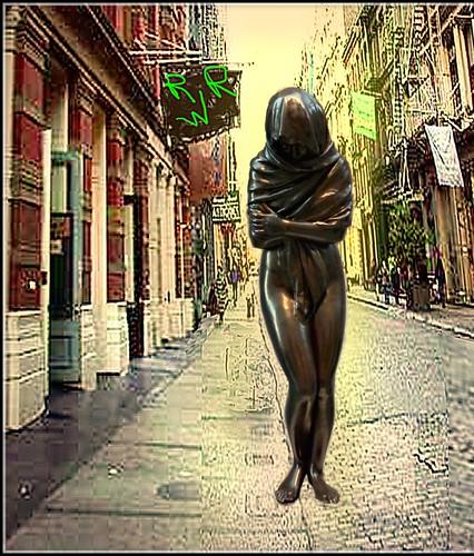 sad statue on Soho Street