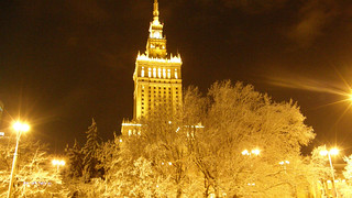 bright golden palace of culture and science warsaw night