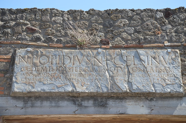 Temple of Isis, copy of dedicatory inscription to the temple reconstruction after the earthquake of AD62, financed by the freedman Numerius Popidius Ampliatus in the name of his son Celsinus, Pompeii