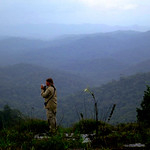 Ornithologist Brian O'Shea gets a first look at the bird life in the boarder mountains of southeastern Suriname during the recon. Photo by Andrew Short.