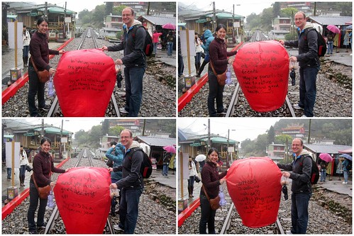 Mei and Dan with each side of their sky lantern before sending it off.