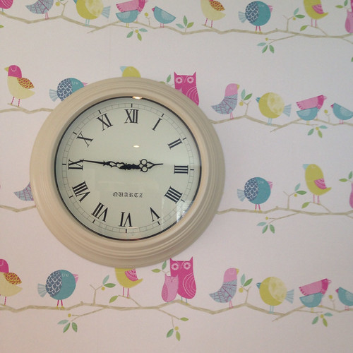 The wallpaper in our kitchen, with our 'vintage' clock