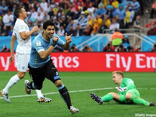 SAO PAULO, BRAZIL - JUNE 19: Luis Suarez of Uruguay celebrates scoring the opening goal during the 2014 FIFA World Cup Brazil Group B match between Uruguay and England at Arena de Sao Paulo on June 19, 2014 in Sao Paulo, Brazil.  (Photo by Chris Brunskill