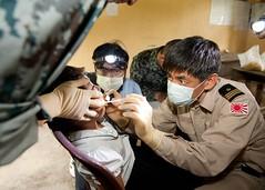 Noritaka Yahara, a Japan Maritime Self-Defense Force dentist, examines a child's teeth at Hunsen Khrong School in Sihanoukville, Cambodia, during Pacific Partnership. (U.S. Navy/MCC Greg Badger)