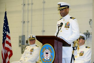 Cmdr. Michael S. Fredie reads his official orders and accepts the responsibilities as commanding officer the Coast Guard Tactical Law Enforcement Team (TACLET) South during a change of command ceremony at Coast Guard Air Station Miami, Friday. Fredie was previously assigned as the Career Management Branch Chief of Personnel Service Center in Arlington, Virginia. U.S. Coast Guard photo by Petty Officer 2nd Class Sabrina Laberdesque.