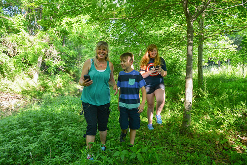 Image of a family geocaching.