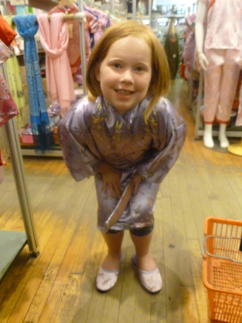 Trying on kimono and slippers in Pearl River