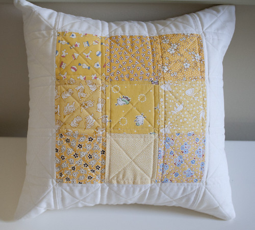 Yellow quilted pillow