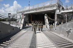 Cadets from the University of Malaysia Sarawak walk the ramp of USNS Fall River (T-EPF 4) during a tour in Kuching, April 16. (U.S. Navy/Grady T. Fontana)