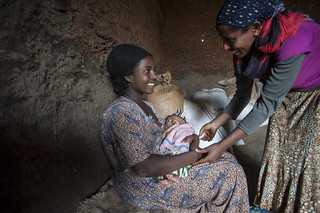 Tena Esubalew Health Extension Worker comes to  Etenesh Belay's house for counselling on breast feeding practices