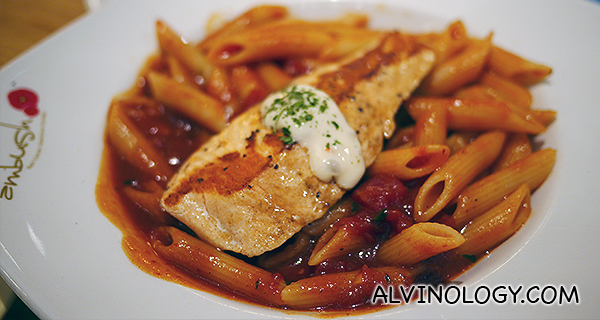 Tomato-based pasta with salmon fillet