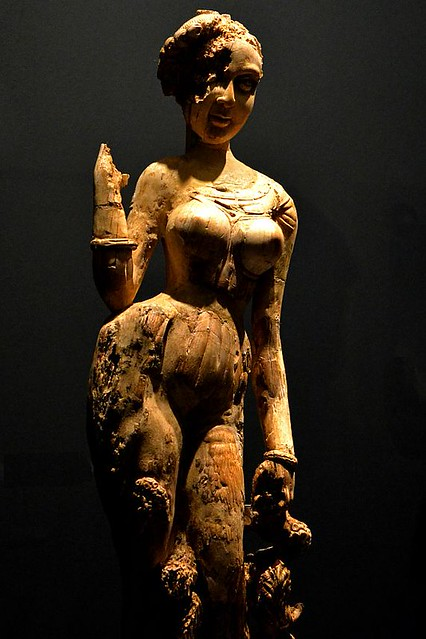 Statuette of a Woman Standing on a Makara