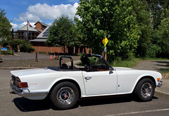 automobile, vehicle, performance car, antique car, classic car, vintage car, land vehicle, luxury vehicle, triumph tr6, convertible, sports car,