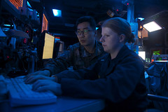 Lt. j.g. Courtney Keiser, right, works with Republic of Korea Navy Lt. Hyeoung Seok Noh in the combat information center aboard USS John S. McCain (DDG 56) during SHAREM. (U.S. Navy/MCSN Alonzo M. Archer)