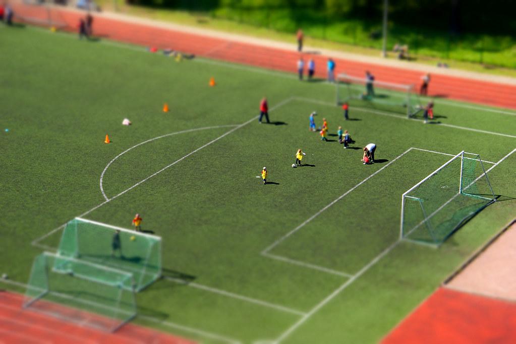 Miniature Kids on Soccer Field