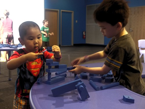 Cousins working together on a Blue construct
