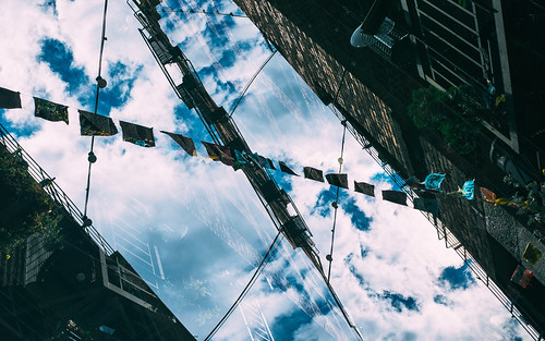 flags sky seattle pacificnorthwest ricohgr alley clouds downtown architecture up abstract lines pnw washington johnwestrock