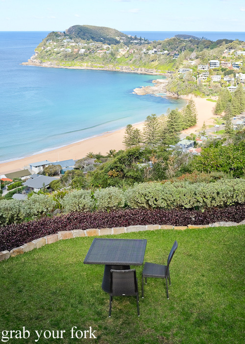 Outdoor terrace dining with sweeping views of Whale Beach at Jonah's
